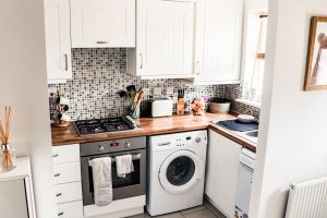 A small kitchen with not much counter space for appliances